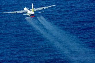 Out of sight, out of mind? Maybe, but the widespread spraying of dispersants doesn't 'clean up' an oil spill. In fact, research suggests it actually just makes it more toxic. [Photo: US Navy]