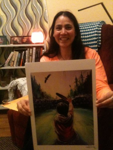 Annie holding Fanny Aishaa's take on the iconic picture taken by APTN's Ossie Michelin. It will be available at Sunday's silent auction. Photo facebook