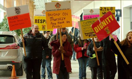 Earlier this month the Eurest cleaners, members of Teamsters Canada, together with other airport workers rallied at the airport to tell the Airport Authority to step up. Now they want your help. Photo Trevor Beckerson, Facebook