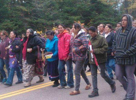 Annie Clair, centre, will be heading to Moncton soon to face charges relating to the violent actions of New Brunswick RCMP against defenders of the land in Kent County, New Brunswick. She needs help paying her legal fees. Photo Facebook
