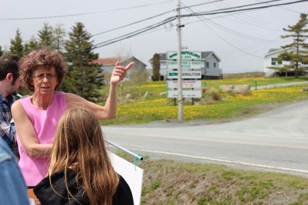 Marlene Brown, a Harrietsfield resident of over 30 years, stands across from RDM Recycling and educates community members about the pollution from the site, how to test their wells and where to get safe water from. [Photo: R. Hussman]