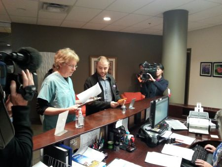 Dr. Timothy Bood and James Hutt of the NS Citizens' Health Network file an official complaint against the College of Physicians for what they believe is an endorsement by the college of healthcare privatization. Photo Robert Devet