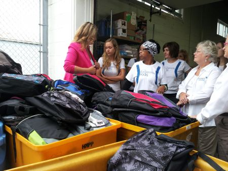 Feed Nova Scotia's Karen Theriault speaks with Bell Aliant volunteers Thursday morning after receiving 2000 backpacks from Bell Aliant's Backpacks for Kids program. Feed Nova Scotia will distribute the backpacks full of school supplies to kids across the province so they are ready to go back to school in September.