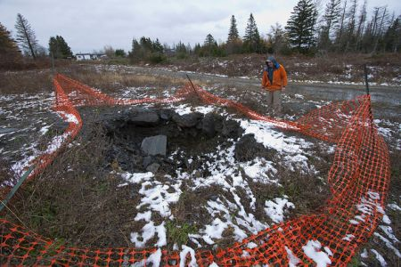 Test pit at the DDV Gold property in Moose River Gold Mines on the Eastern Shore.  Critics charge that in Nova Scotia mining interests take precedence over any concerns Nova Scotians may have. Photo by Dan Hutt, all rights reserved