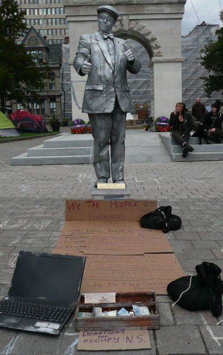 """""""Enough is enough,"""" says Granite Man, who is splitting his earnings with Occupy Nova Scotia."""