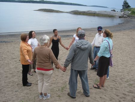 People holding hands for Hands Across the Sand in Point Pleasant Park