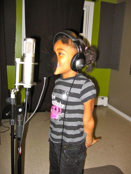 Ma'kay, 6, enjoys singing in the studio recording room but also has interests in producing.