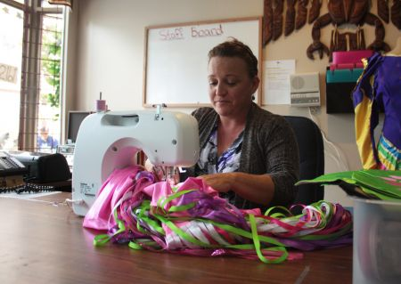 Donna, at the Mi'kmaq daycare, sews a child's pink skirt. Photo by Hilary Beaumont