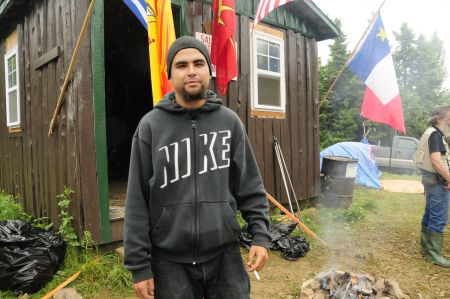 Thomas in front of the Skidoo Shack on Bronson Road where a truck was seized on July 27 (Photo: Rana Encol)