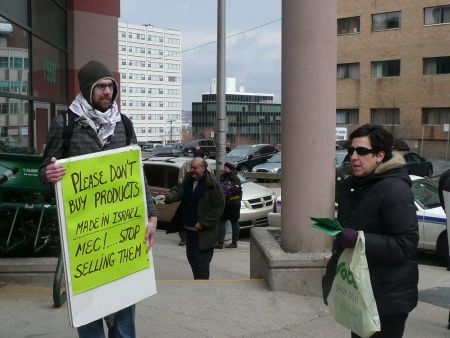 David Parker and Jackie Barkley handing out pamphlets outside the outdoor equipment store in downtown Halifax.