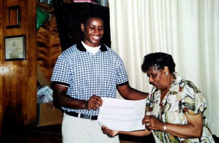Jerome Downey receives the first Buddy Daye Scholarship in 2003. (Photo Contributed by Jerome Downey)