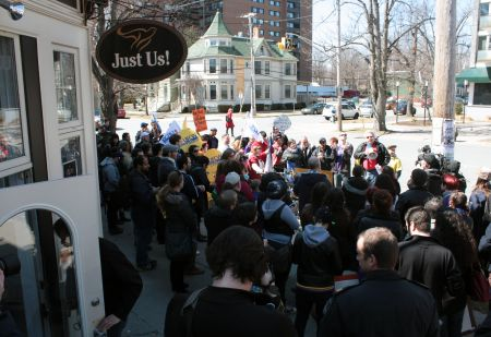 About 120 people gathered outside Just Us! on Spring Garden Road in April. (Photo by Hilary Beaumont)