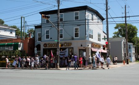 About 40 people gathered outside the Quinpool Road Second Cup on Saturday. (Photo by Hilary Beaumont)