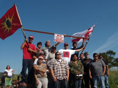 Peter Bernard (front row left), Ginny Marshall (front row centre-right), Emmett Peters (back row far right) and other Mi'kmaq Warriors and supporters at the site of Friday's partial road blockade (Ben Sichel photo).