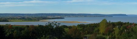 The tidal river empties into the Minas Basin, under the watchful eye of Blomidon. Photo © Marke Slipp