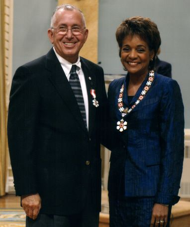 Daniel N. Paul and Governor General Michaelle Jean. 1st Medallion:Order of Nova Scotia. 2nd Medallion: Order of Canada.