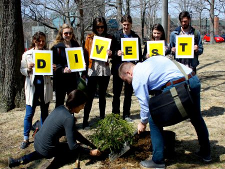 Divest Dalhousie members gather together to plant a tree, during the President's Advisory Council of Sustainability meeting, April 22nd. [Photo: Kendra Lovegrove]
