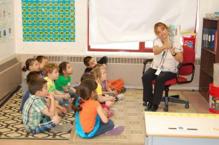 Eskasoni teacher Gail Stevens reads a story in Mi'kmaq to a grade primary class. Photo courtesy of Ida Denny