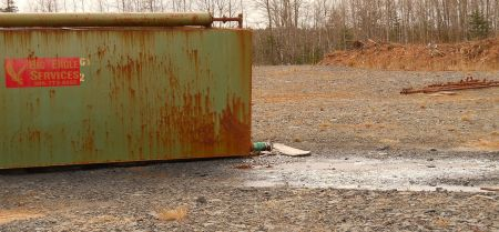 One of the frack-wastewater holding tanks in Kennetcook. Clearly leaking. [Photo: Steve Wendland]