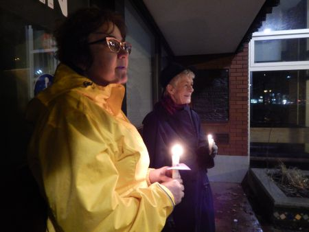 Heavy rains on Saturday night moved the candle lit vigil inside but two volunteers kept their candles burning over Gottingen Street.