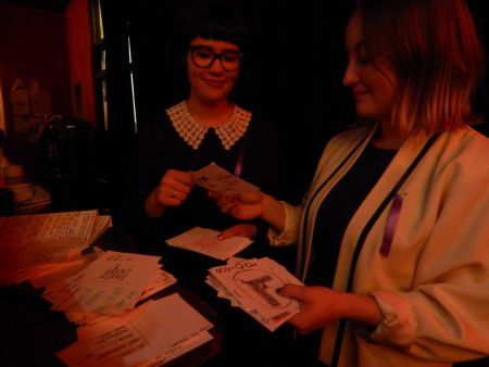 Katelyn Armstrong and Eliza Leitch collect postcards done by the audience for their Halifax for a Public Inquiry letter writing campaign. Armstrong and Leitch started the project from a assignment at the School of Social Work at Dalhousie. The postcards will be taken to the House of Commons by NDP MP Megan Leslie.