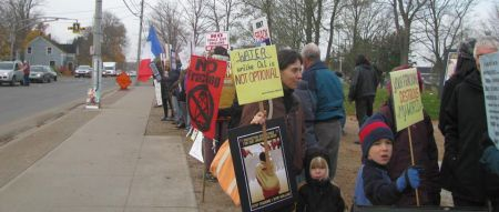 A combination of handmade & printed signs sent the message out; Kings/Hants does NOT want fracking to happen here! Note, on the far left, one person handing out leaflets to passers-by.