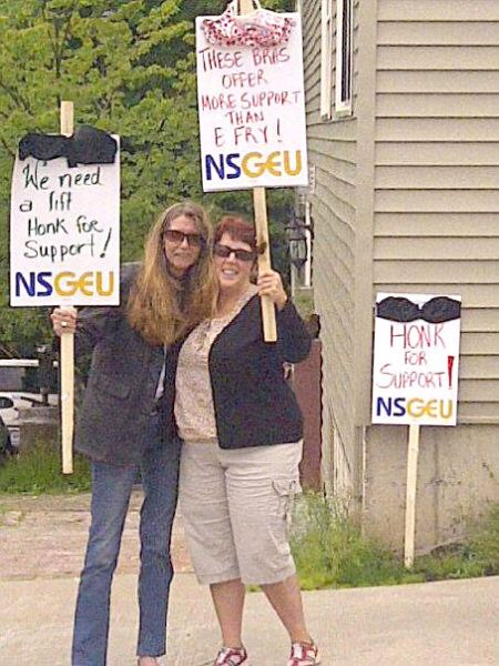 """From the website of NSGEU Local 68: """"NSGEU Local 68 members Heather McKenzie (left) and Lynn Yetman take time out on their lunch break on Wednesday, June 27, to call for fairer treatment by their employer, the Elizabeth Fry Society of Mainland Nova Scotia."""""""