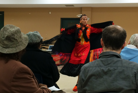 The presentation began with traditional fancy shawl dancing and drumming, followed by performers singing the Mi'kmaq honour song. (Photo by Hilary Beaumont)