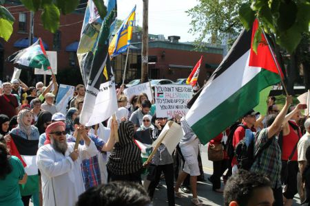 Close to 300 protesters marched through downtown Halifax yesterday to raise awareness of Israel's ongoing attacks on Gaza city.  Photo Randa Ataya