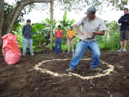 Gregorio Ajcot creates a permaculture design with participants at a workshop at IMAP. (Photo courtesy of IMAP)