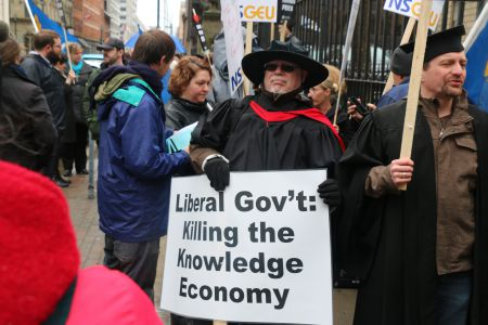 Larry Haiven was amongst about 100 protestors who took to the streets against Bill 100, on April 27th in Halifax. [Photo: M. Howe]