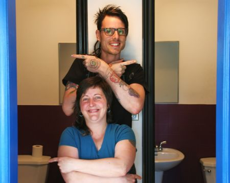 Carol and Jeff Outside the Gender Neutral Good Food Emporium Bathrooms. [Photo: Miles Howe]