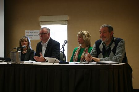 Panel at the launch of the report on homelessness in HRM. Numbers don't suggest that things are geting better at all. Claudia Jahn (AHANS), Dan Troke (Housing NS), Sue LaPierre (United Way Halifax), Jim Graham (AHANS).  Photo Robert Devet