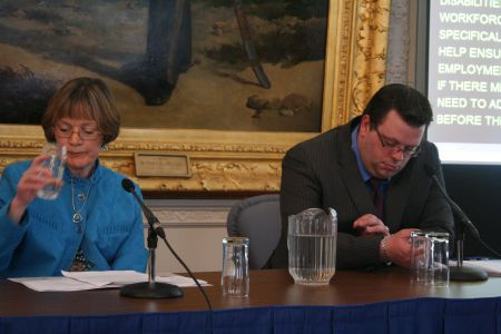 200 people with disabilities may lose their jobs if funding for their support workers is cut off on April 1st. Heather Downey, mother of a child who lacks social skills, and Andrew Stratford, who experiences bouts of anxiety, raise the alarm at a press conference.  Photo Robert Devet