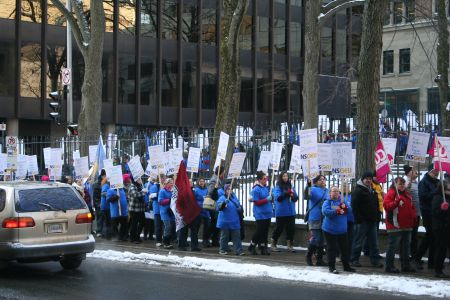 Hundreds of striking Home Support Workers surround the Nova Scotia Legislature.  They were there to protest essential services legislation that NSGEU President Joan Jessome calls draconian.   Photo Robert Devet