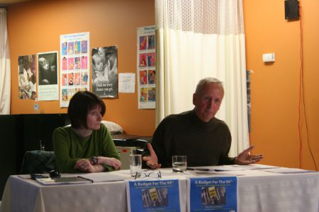 Economist Michael Bradfield makes a point while Nova Scotia CCPA director Christine Saulnier looks on. The 2014 alternative budget is a comprehensive document that rejects austerity and calls for fundamental changes to the way budget priorities are set. Photo Robert Devet