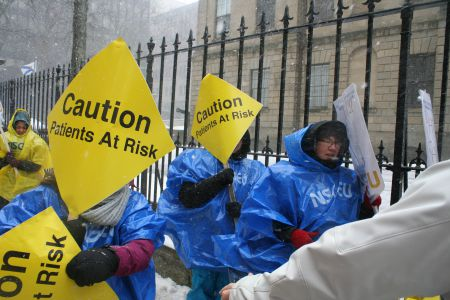 NSGEU members braving blizzards and freezing rain to show their displeasure with back-to-work legislation at Province House.  Photo Robert Devet