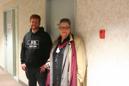 Spokespersons Margaret Anne McHugh and Kyle Buott took part in the occupation earlier this morning, but after talking to the press in the hallway found themselves locked out of Regan's office.  Photo Robert Devet