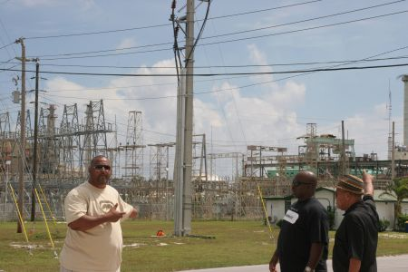 Troy Garvey, Jonathan Glinton and Etienne Farquharson stand in front of the old Grand Bahama Power Station. Critics say the old plant could have been retrofitted for a fraction of the $80 million Emera recently spent on building a new power station, where allegations of union busting are rampant (Miles Howe photo).