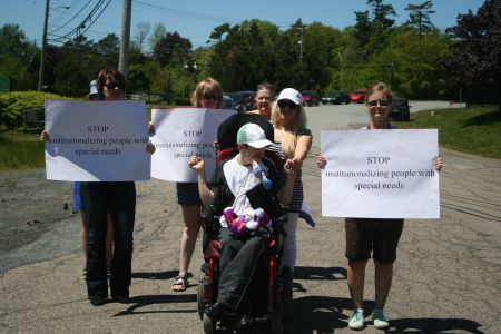 Between 30 and 40 people rallied at Lower Sackville's Quest Rehabilitation Centre to call for the speedy closure of institutions for people with intellectual disabilities.  Rallies like this one occurred all over Nova Scotia. Photo Robert Devet