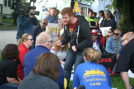 President of the Halifax-Dartmouth & District Labour Council Kyle Buott leads the crowd in a particularly energetic chant.  Photo Robert Devet