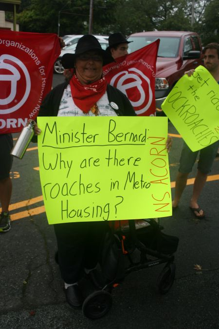 Dartmouth tenants, tired of cockroaches and bedbugs, rally at Community Services minister Joanne Bernard's constituency office in Dartmouth. Photo Robert Devet