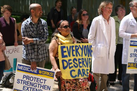 Healthcare and refugee advocates joined forces to protest federal cuts to refugee healthcare, in Halifax and other Canadian cities. Photo Robert Devet