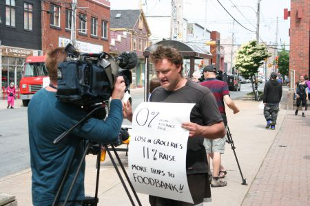 Kendall Worth fought the Community Services decision to disallow his special diet all the way to the Nova Scotia Supreme Court. Here he can be seen explaining the issue to the press during a recent anti-poverty rally in Halifax. Photo Robert Devet