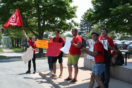This day and age internet access should not be restricted to people who can afford its high costs, say members of Nova Scotia ACORN. They rallied at the CRTC office on Wyse Road in Dartmouth. The CRTC is studying the issue. Photo Robert Devet