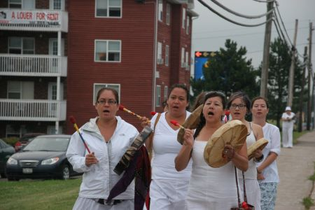 Women in white gathered at the Holiday Inn in Moncton to protest SWN Resource Canada's continued seismic testing in New Brunswick. [Photo: Miles Howe]