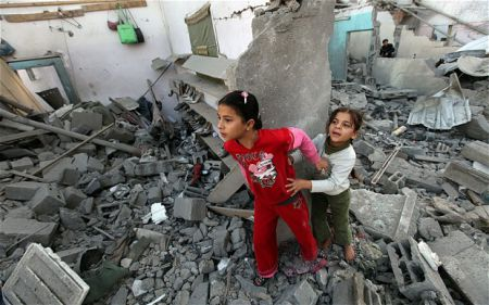 Two children in Gaza house ruins.  Photo by the Telegraph, London.