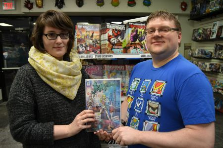 Katie Lantz (left) and Darryl Wall (right) of Giant Robot Comics show off the next '80s nostalgic icon they're bringing to Halifax via an exclusive store cover – this time, it's Jem and the Holograms (or rather, their rivals, the Misfits)!