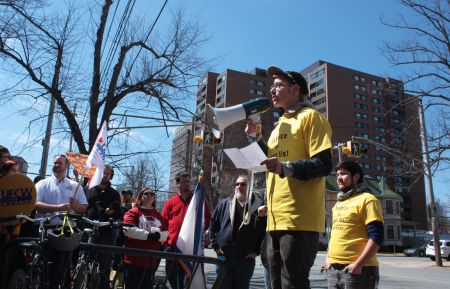 A Just Us! employee who says he was unfairly dismissed speaks at a rally in early April. (Photo by Hilary Beaumont)