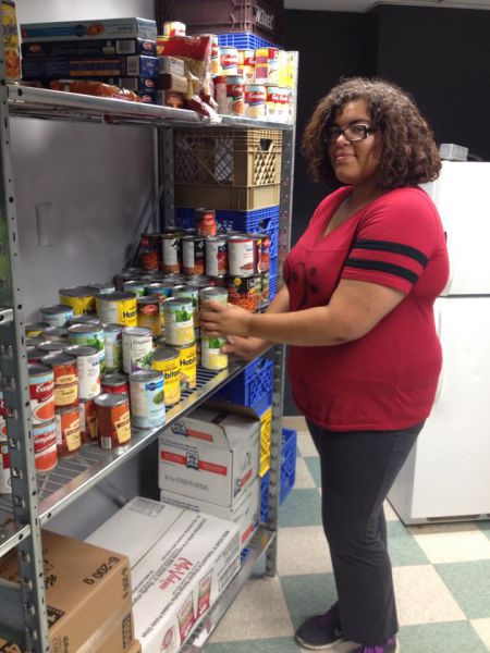 Volunteer Kehisha Wilmot stocking the MSVU Wellness Pantry for incoming students [photo: J. Grant]